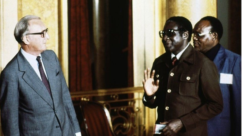 Robert Mugabe, right, is pictured with British Foreign Secretary Lord Carrington at Lancaster House in