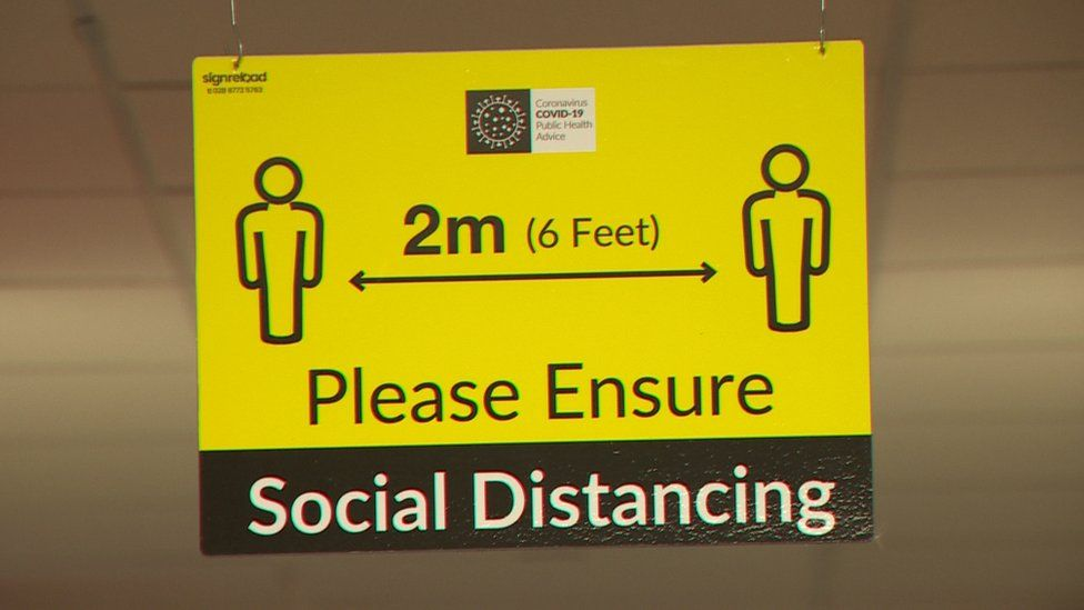 SIGN THAT SAYS '2M - PLEASE ENSURE SOCIAL DISTANCING'