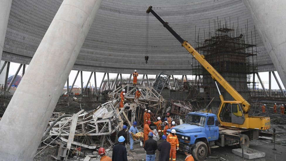 In this photo released by Xinhua News Agency, rescue workers look for survivors after a work platform collapsed at the Fengcheng power plant in eastern China's Jiangxi Province, Thursday, Nov. 24, 2016