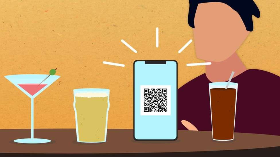 A man using an app to order drinks