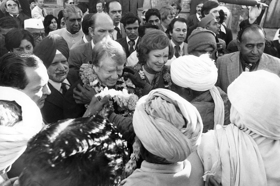 Jimmy Carter being greeted by villagers of 'Carterpuri'