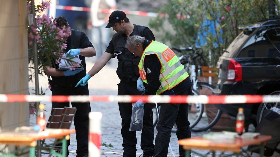 investigators at the scene of the Ansbach bomb on 24 July 2016