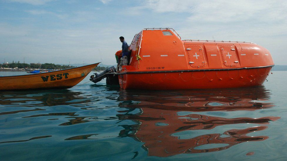 File photo: An empty Australian lifeboat that carried asylum seekers turned back by Australian navy is docked at Pangandaran wharf in western Java island, 8 February 2014