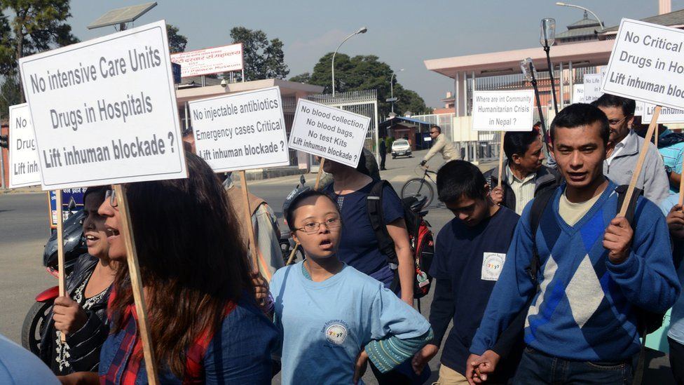 Nepalese activists and hospital patients rally against the block on humanitarian supplies at the Nepal-India border, in Kathmandu on November 23, 2015