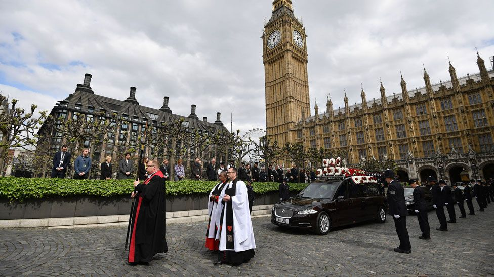 The hearse leaving the Houses of Parliament