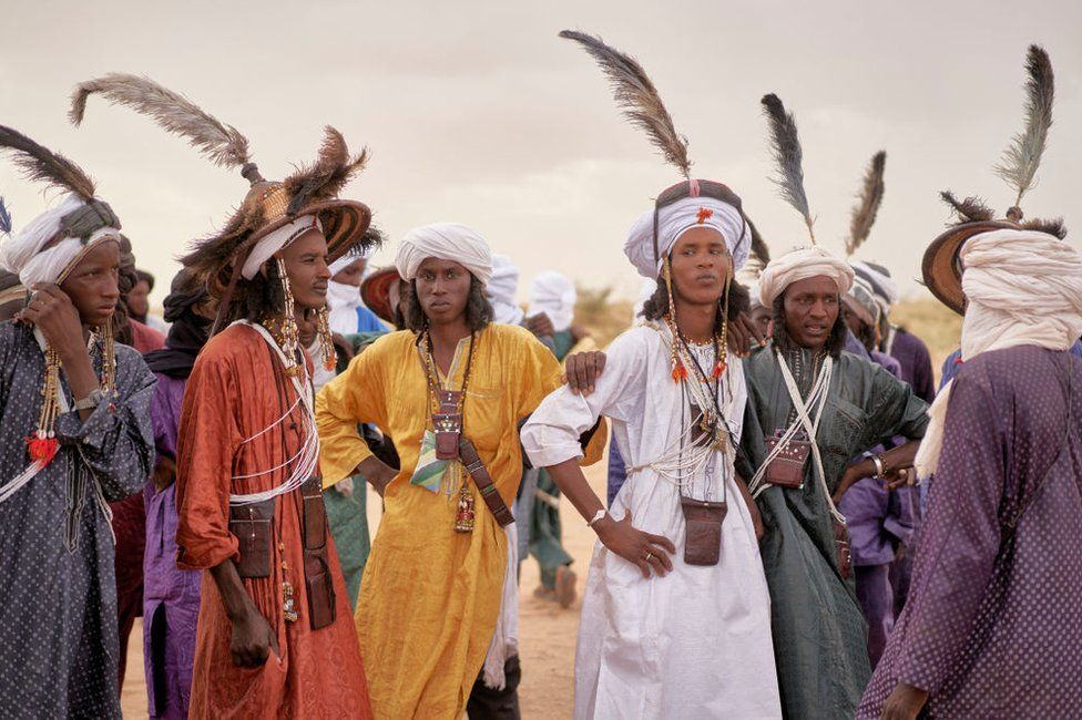 A group of Wodaabe men rest after dancing during the Cure Salee, in Ingall, northern Niger, on 18 September.