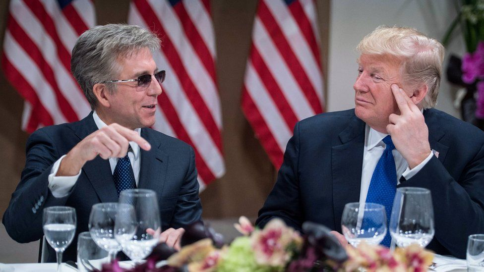 US President Donald Trump (R) listens to SAP CEO Bill McDermott during a working dinner with European business leaders during the World Economic Forum (WEF) annual meeting in Davos, eastern Switzerland, on January 25, 2018.