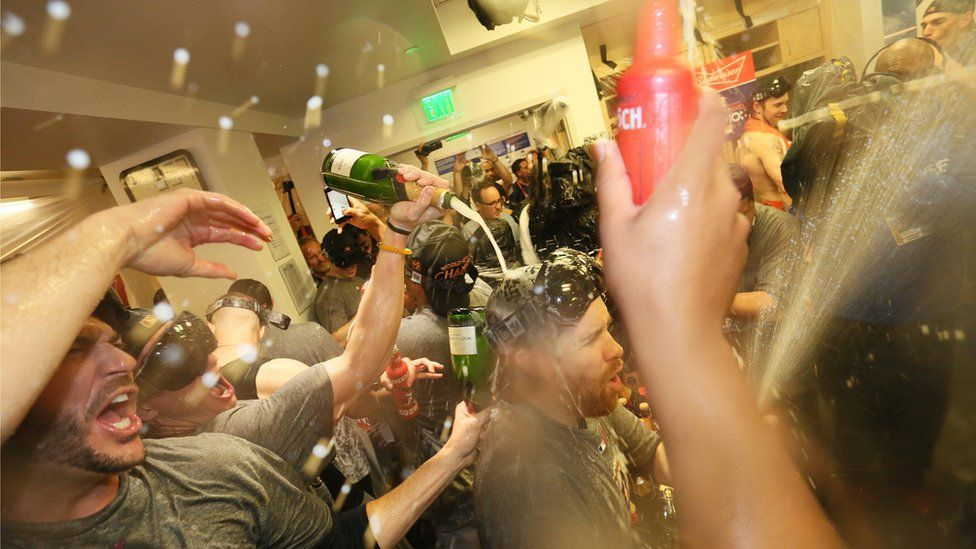Houston Astros celebrate in the clubhouse