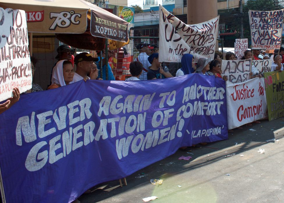 Survivors calling for justice at a demonstration
