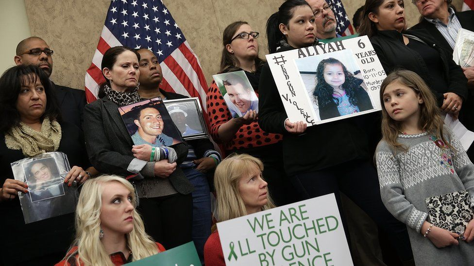 Sandy Hook families hold pictures of their loved ones