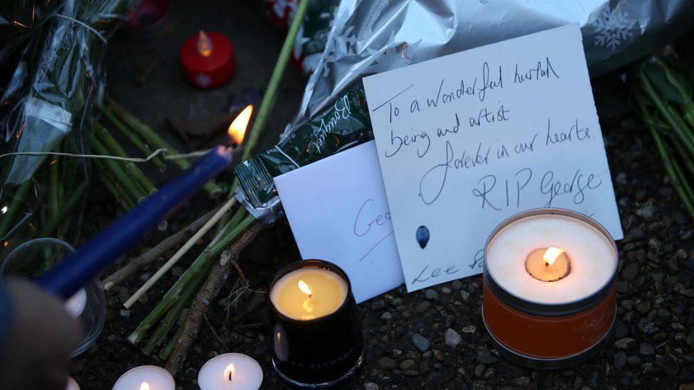 Fans leave floral tributes outside George Michael's home in north London