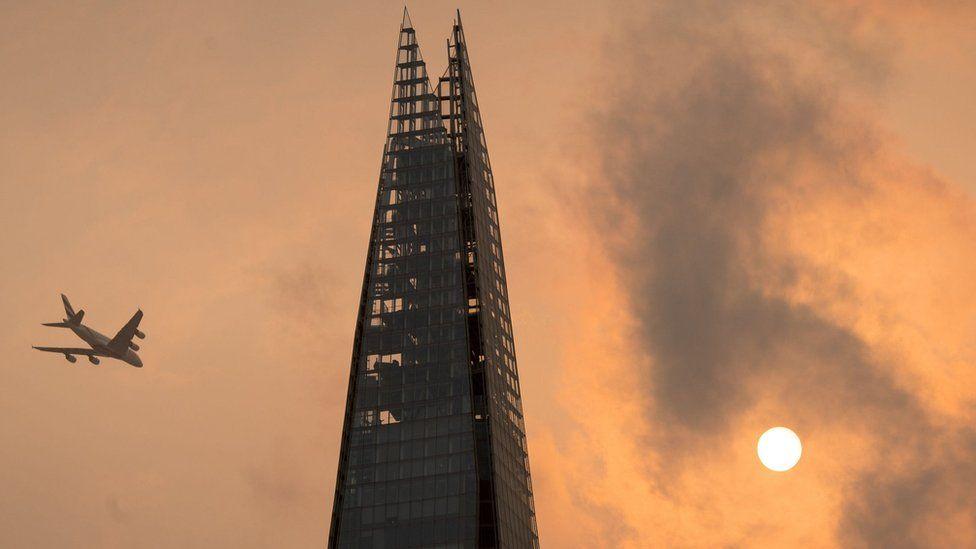 Red sun in sky above Shard