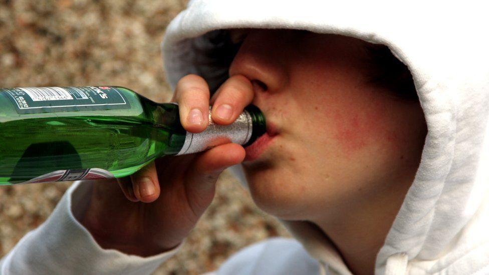 Teenage boy drinking beer
