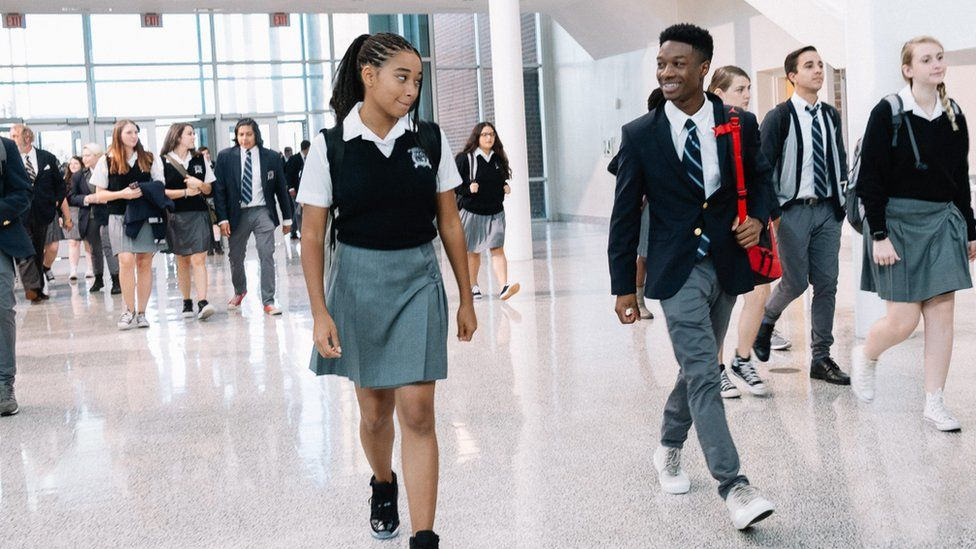 Amandla Stenberg with another cast member in The Hate U Give