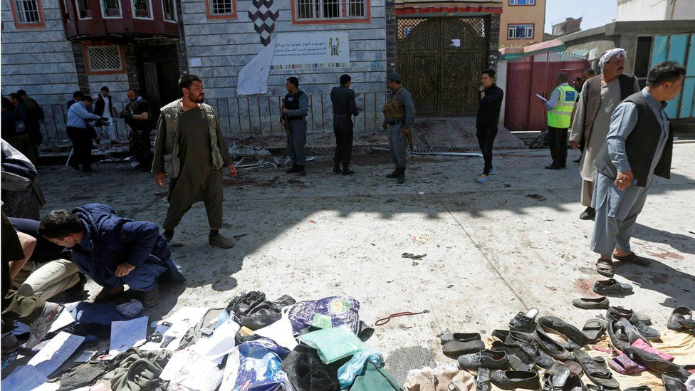 Clothes and sandals are seen at the site of a suicide bomb attack in Kabul, Afghanistan (April 22, 2018)