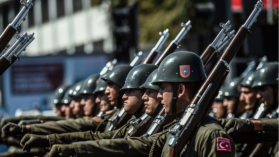 Turkish soldiers march in a military parade