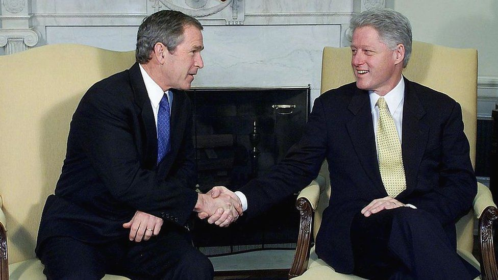 Presidents Clinton and George W Bush inside the White House