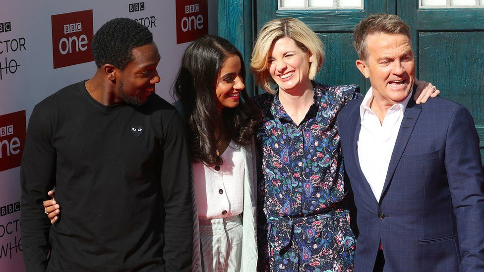 Whittaker with co-stars Tosin Cole, Mandip Gill and Bradley Walsh