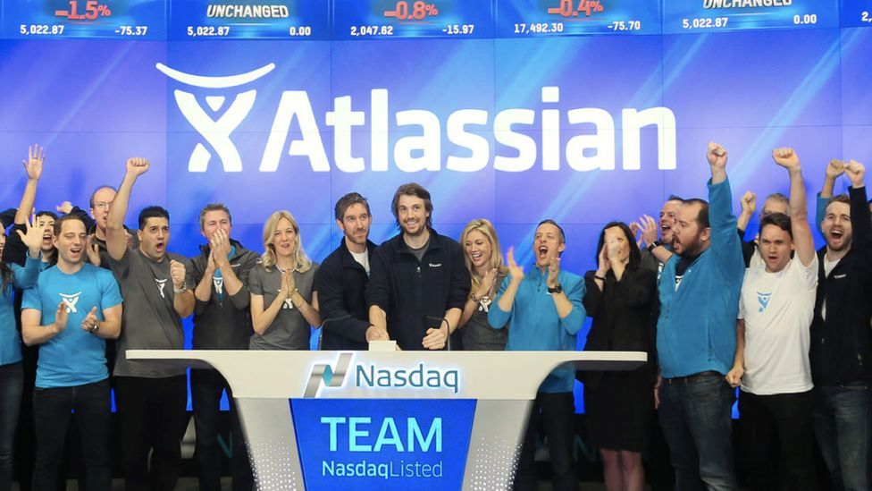 Atlassian co-founders Mike Cannon-Brookes and Scott Farquhar ring the bell at the Nasdaq