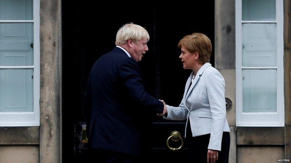 Nicola Sturgeon greets Boris Johnson outside her official residence in Edinburgh in July 2019