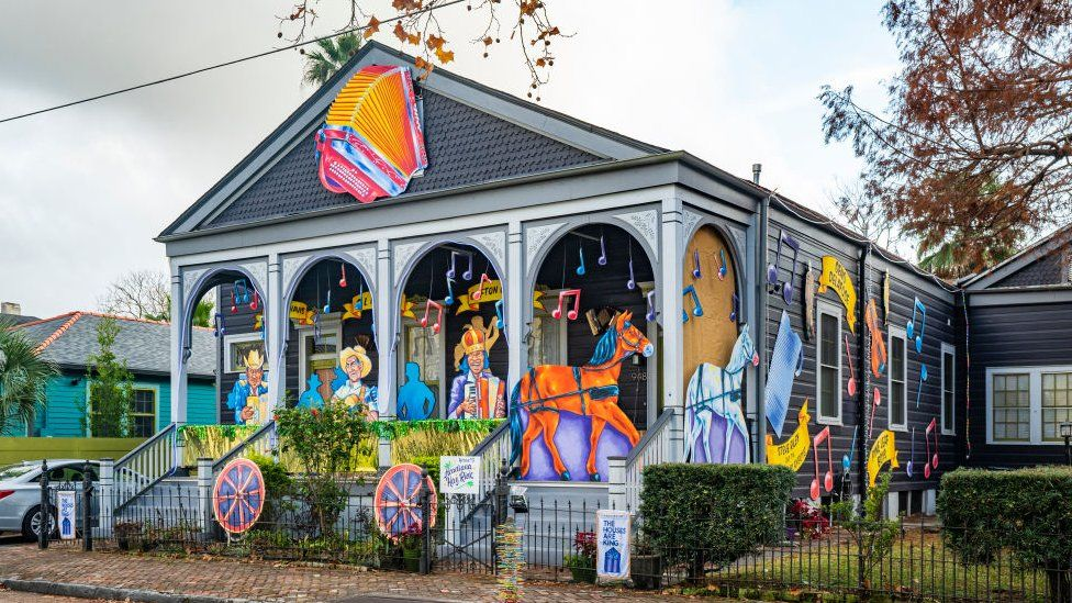 """The Acadiana Hay Ride House, whose decorations are sponsored by Krewe of Red Beans, and pays homage to zydeco pioneers Boozoo Chavis and Clifton Chenier and the """"Cajun Hank Williams"""", DL Menard on January 24, 2021 in New Orleans, Louisiana"""