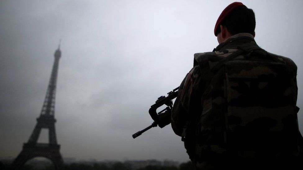 """A French soldier patrols near the Eiffel Tower as part of the """"Sentinelle"""" security plan in Paris on 3 May"""