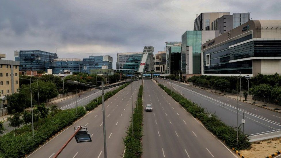 Vehicles move through DLF Cybercity during nation wide lockdown amid Covid-19 coronavirus pandemic in Gurugram