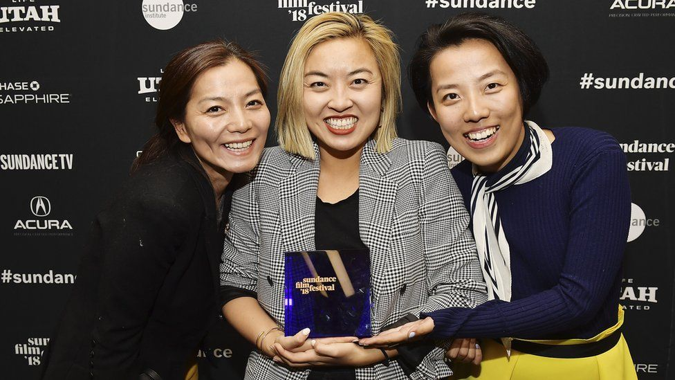 Producer Jane Zheng, director Cathy Yan, and producer Clarissa Zhang backatage after accepting the Special Jury Award for Ensemble Acting for their film Dead Pigs at Basin Recreation Field House on January 27, 2018 in Park City, Utah.