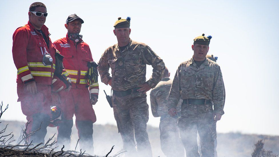Soldiers and firefighters on Saddleworth Moor