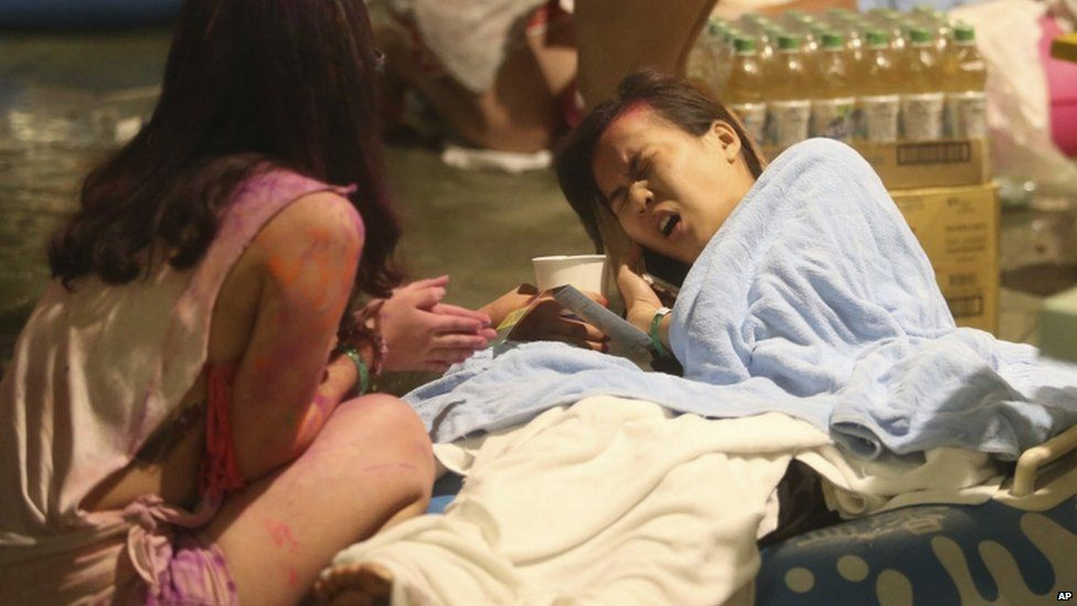 A young woman winces in pain after the fire at the Taipei park, 27 June