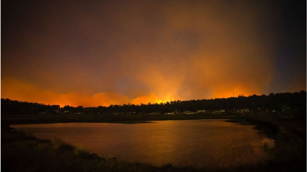 Fires burning dangerously close can be seen from the Central Highlands Lodge from on January 22, 2019 in Miena, Australia