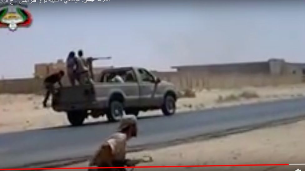 Mohammed Abdallah climbing into a truck in the Libyan revolution