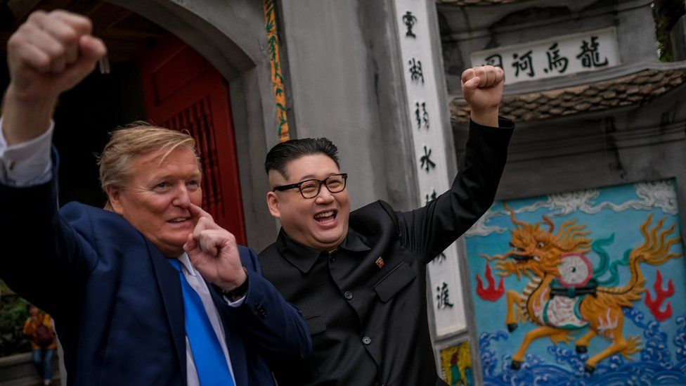 Kim Jung-Un impersonator 'Howard X', and Donald Trump lookalike 'Russell White' posing for photos at Ngoc Son Temple in Hanoi, Vietnam