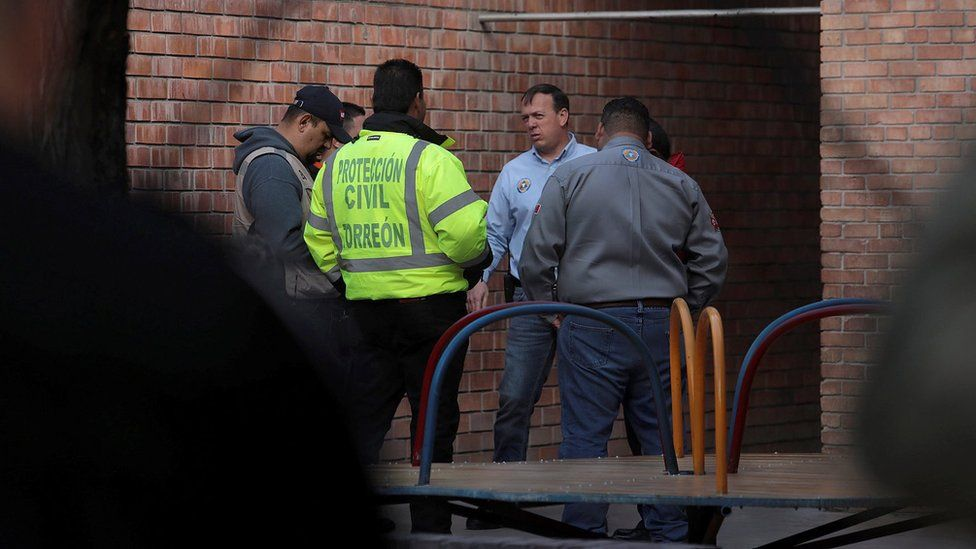 Members of Civil Protection are seen at a private school after a shooting in Torreon