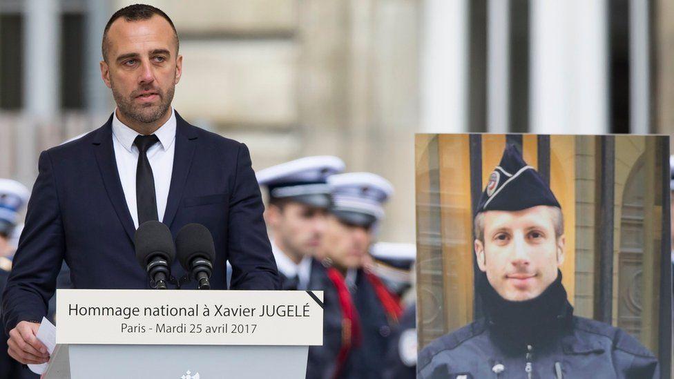 Mr Jugele's partner, Etienne Cardiles, pays tribute at the Paris police headquarters in Paris, France, 25 April 2017