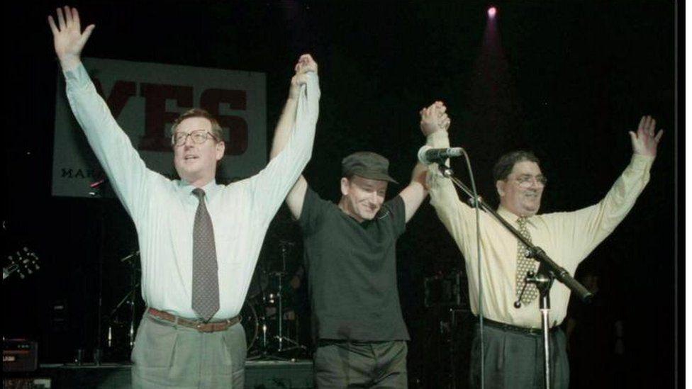 Bono on stage with John Hume and David Trimble