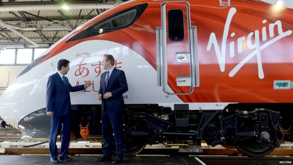 David Cameron and Japanese counterpart Shinzo Abe on a visit to a Hitachi factory last month