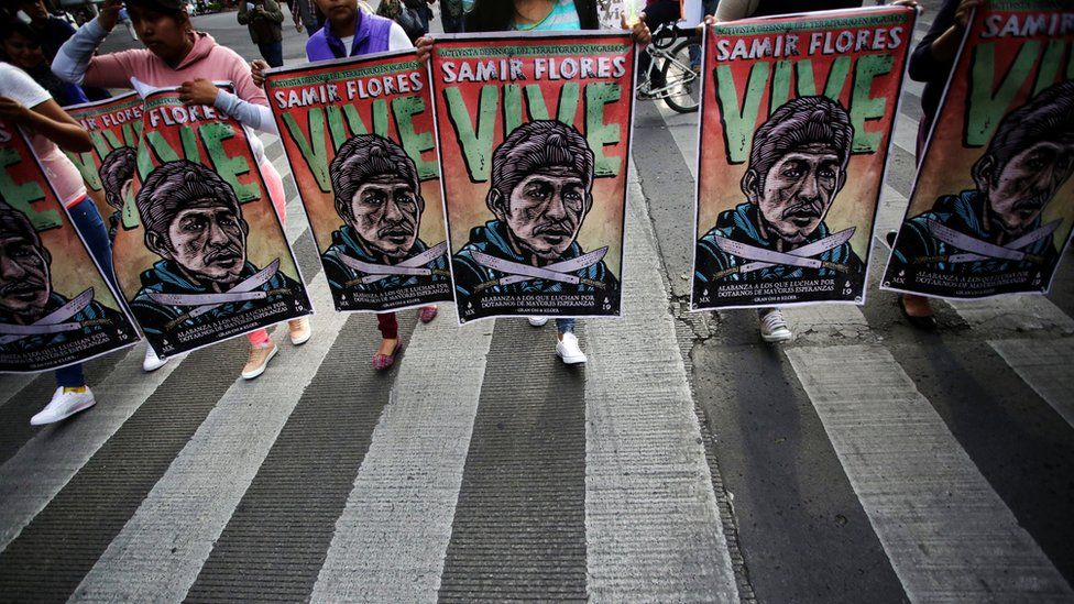 Demonstrators take part in a protest to demand justice for Mexican activist Samir Flores Soberanes