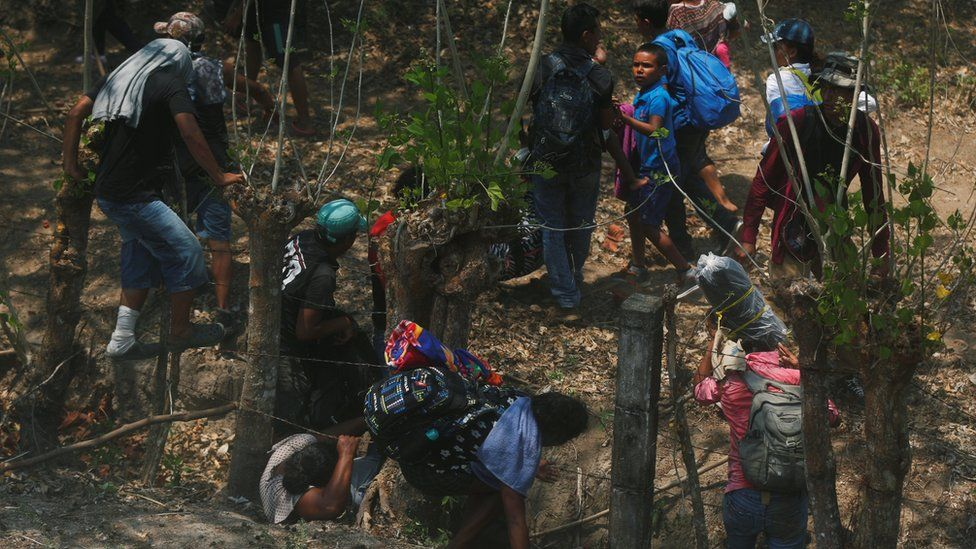 Central American migrants try to flee during an immigration raid on their journey towards the United States