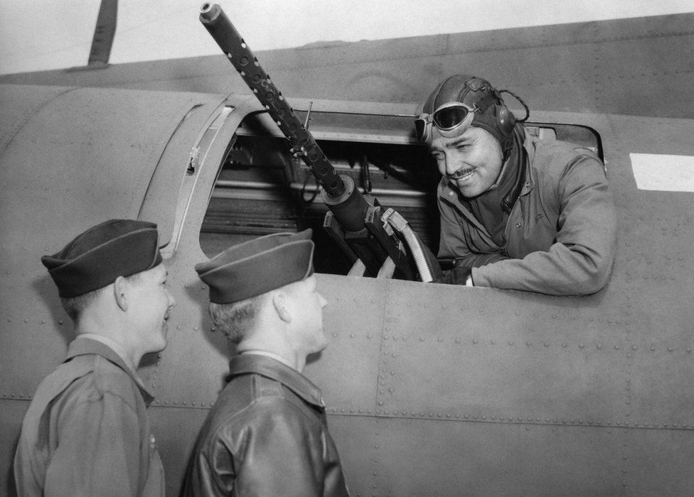 Captain Clark Gable talks to Sergeant Phil Hulse and Sergeant Kenneth Huls of the 351st Bomb Group