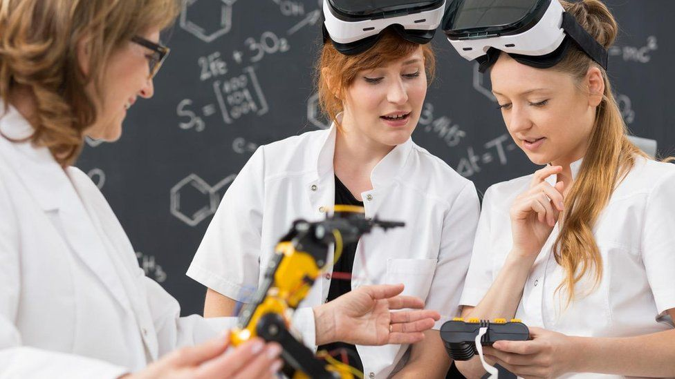 Girls wearing VR headsets