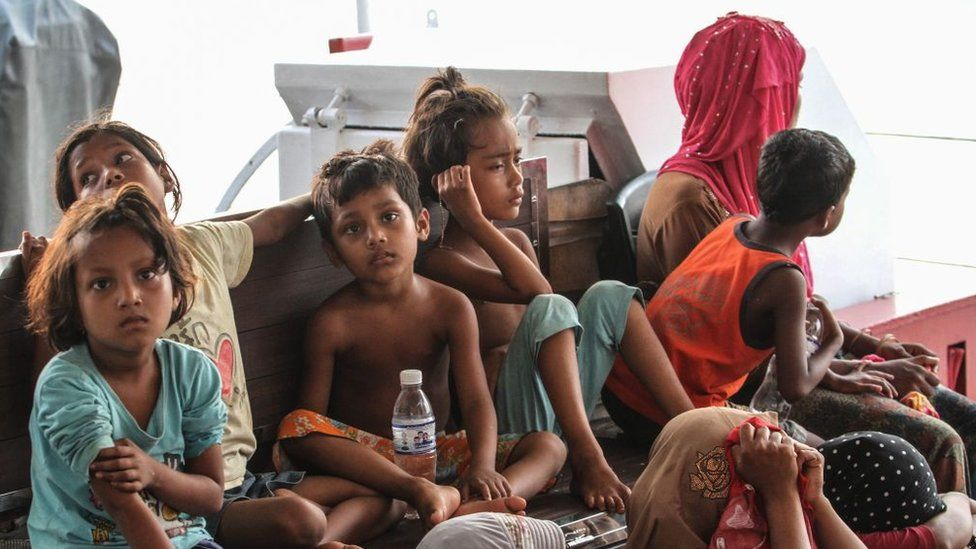 Rohingya refugees detained in Malaysia territorial waters off the island of Langkawi arrive at a jetty in Kuala Kedah