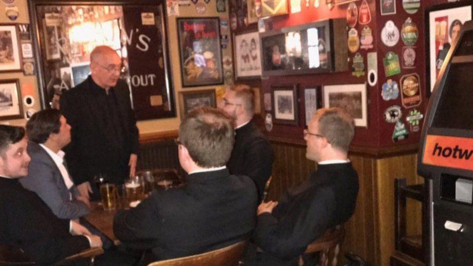 Priests in pub