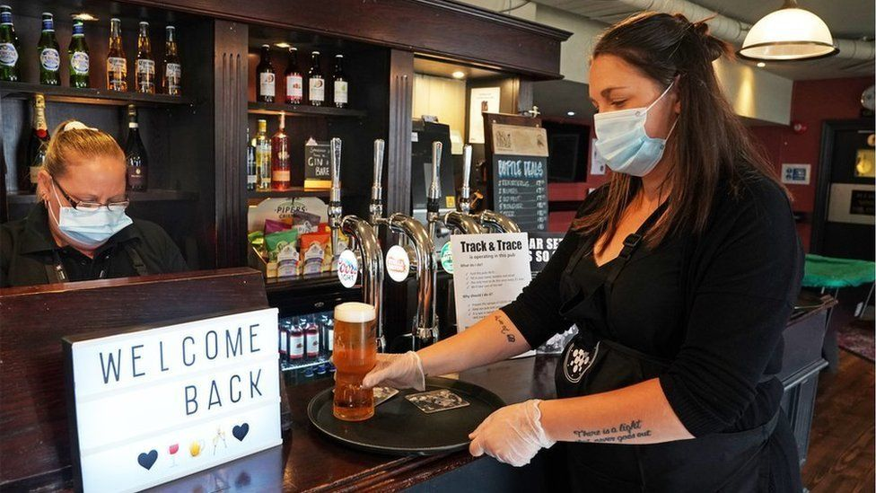Members of staff wearing PPE at The Victoria in Whitley Bay, as pubs and bars have reopened following the easing of coronavirus lockdown restrictions across England.