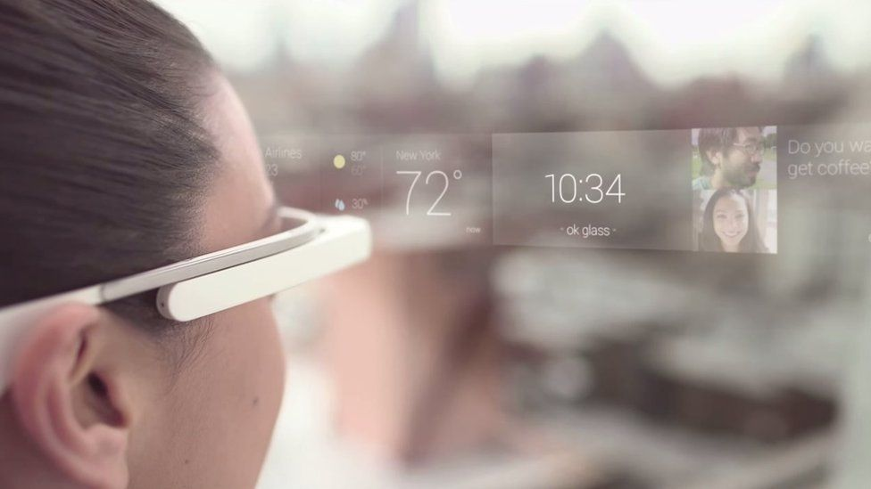 Woman wearing Google Glass showing heads up display
