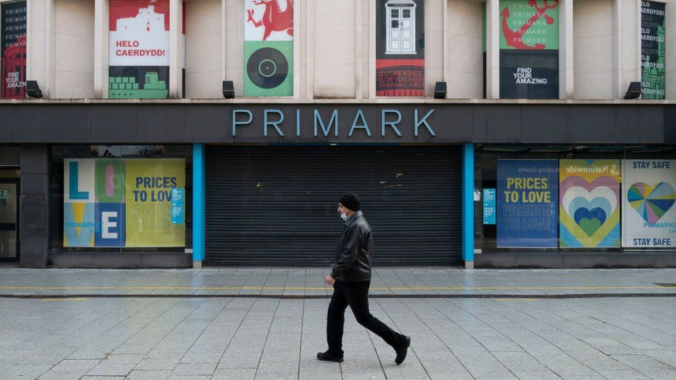 Chart showing a man walking by a Primark