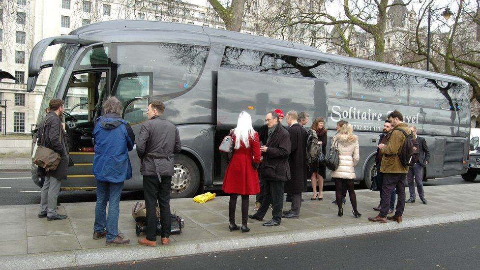 Passengers on coach tour of central London