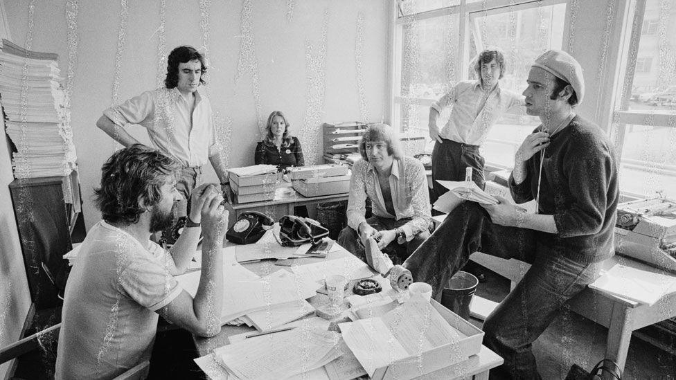 Neil Innes (right in hat) in a script conference for BBC television show Monty Python's Flying Circus in 1974