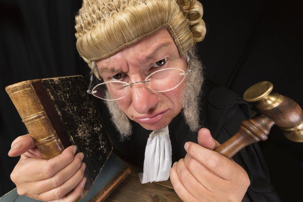 Judge with book and gavel