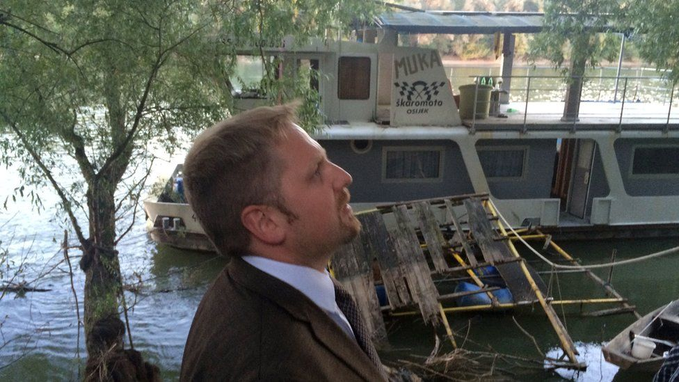 Vit Jedlicka in front of a boat he has just bought - the first of the Liberland fleet